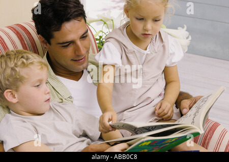 Father reading story - Stock Photo
