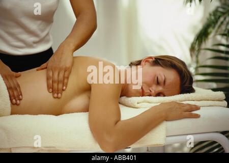 Woman having back massage - Stock Photo