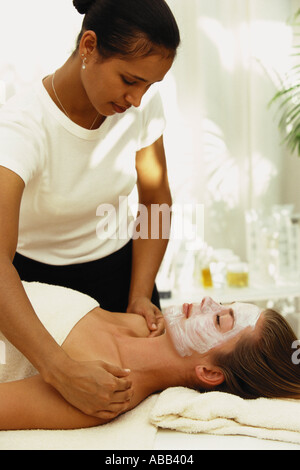 Woman having shoulder massage - Stock Photo