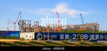 Stadium for 2008 Olympic Games dubbed the 'Bird's Nest' under construction May 2006 Beijing China JMH1568 - Stock Photo