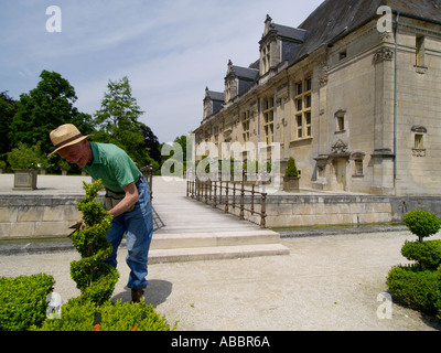 Gardener working in the garden of the renaissance chateau in Joinville built by Claude de Lorraine Champagne region - Stock Photo