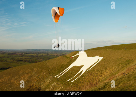 Paragliding over Westbury White Horse, Wiltshire, England - Stock Photo