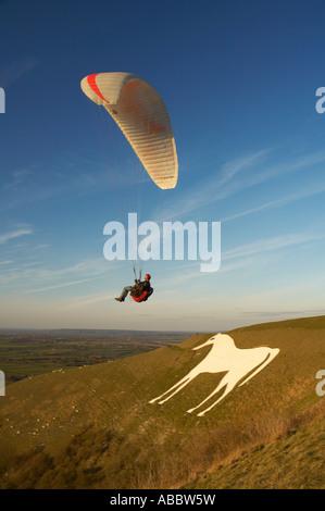 Paragliding over Westbury White Horse, Wiltshire, England - Stock Photo