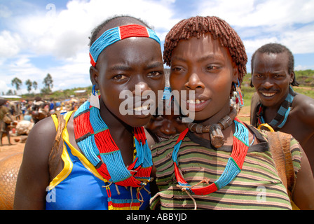 Portrait two young girls of the Banna people wearing colourful necklaces on the market of Keyafer Ethiopia - Stock Photo