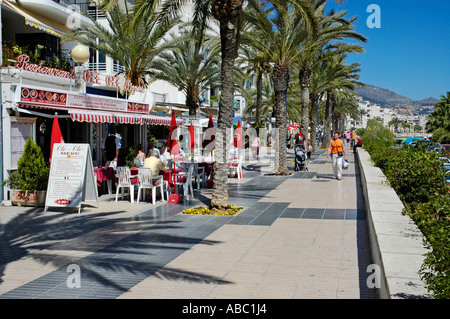 Tourists Walking On The Promenade Of Costa Adeje Tenerife