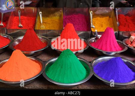 Piles of coloured powder on sale at the Devraja Urs Market in Mysore, Karnataka, India. - Stock Photo