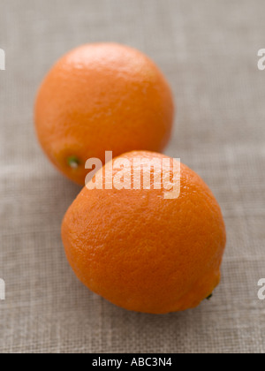 Oranges on linen - high end Hasselblad 61mb digital image - Stock Photo