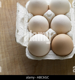 White and brown eggs - Stock Photo