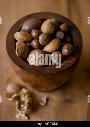 Mixed nuts in wooden bowl - high end Hasselblad 61mb digital image - Stock Photo