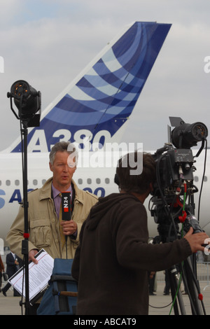TV television news reporter and cameraman during live broadcast about the new Airbus A380 Airbus airliner - Stock Photo