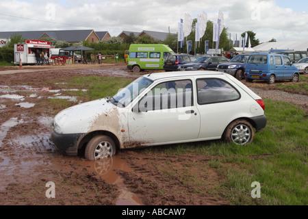 Car stuck in mud muddy car park at Hay Festival May 2006 - Stock Photo