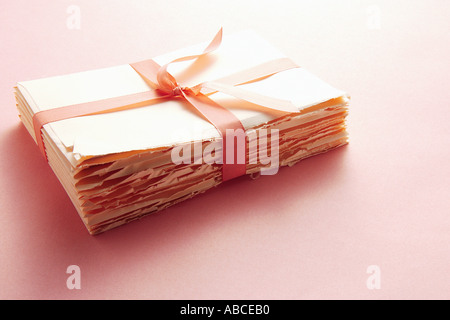 Letters tied with ribbon - Stock Photo