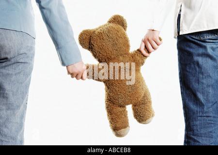 Couple holding teddy bear - Stock Photo