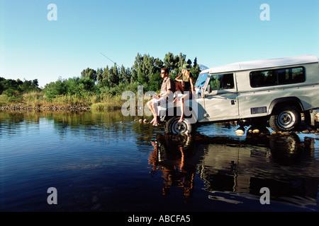 Couple fishing on a safari
