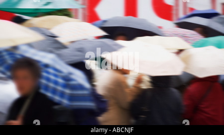 Crowd of people with umbrellas - Stock Photo