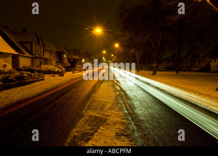 light trails of cars on a suburban street in birmingham uk - Stock Photo