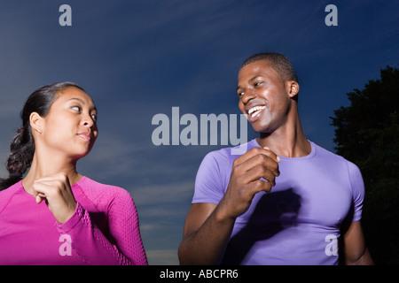 Man and woman jogging - Stock Photo