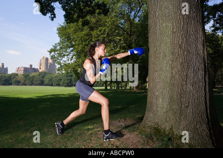 Woman boxing in the park - Stock Photo