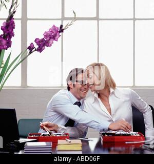 Eating and flirting at work - Stock Photo