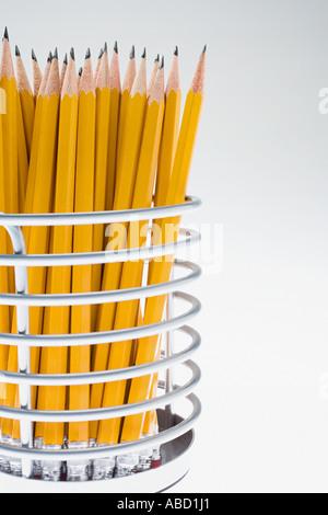 Pencils in a desk tidy - Stock Photo