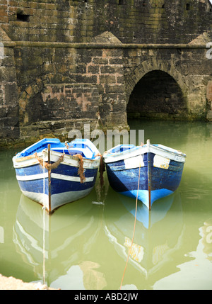 Two blue fishing boats at Essaouira Harbour Morocco - Stock Photo