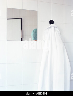 Surgical gown hanging on wall - Stock Photo