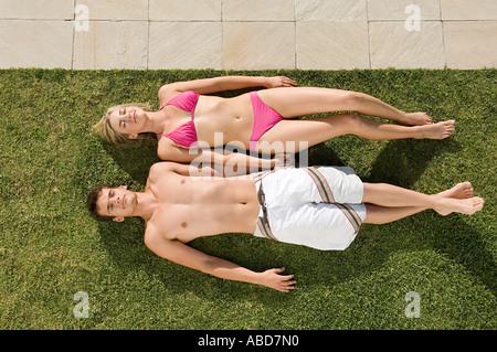 Young couple sunbathing - Stock Photo