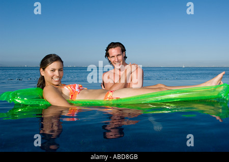 Couple in the sea - Stock Photo