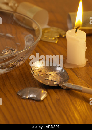 Fortune telling with melted lead - Stock Photo
