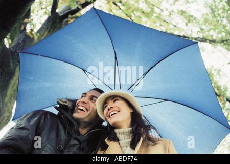 Couple under umbrella - Stock Photo