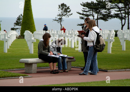 American Cemetery Normandy France School children on an educational visit - Stock Photo