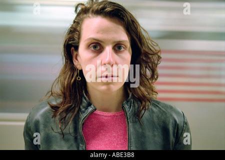 Woman and blurred subway train - Stock Photo