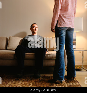 Couple in living room - Stock Photo