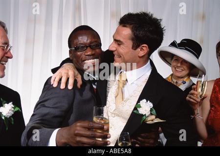 Groom hugs best man - Stock Photo