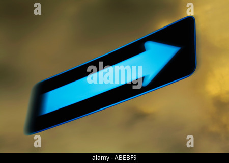 Motion blurred directional one way road sign with blank arrow - Stock Photo