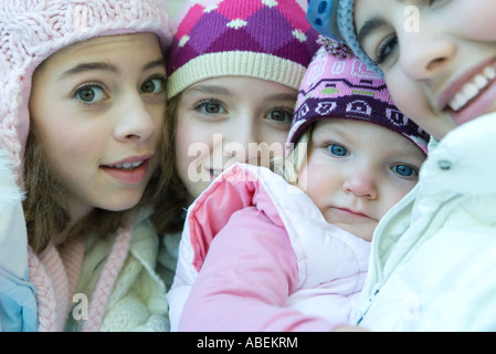 Young siblings wearing winter clothing, portrait - Stock Photo