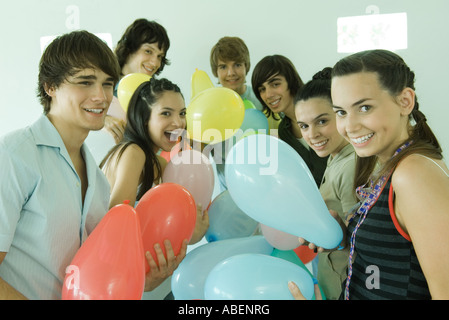 Group of young friends with balloons - Stock Photo