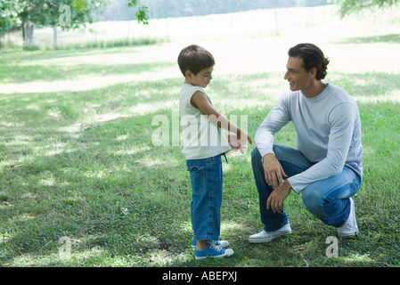 Boy and father talking outdoors - Stock Photo