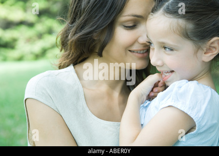 Girl and mother, smiling, portrait - Stock Photo