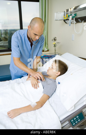 Doctor listening to child's chest with stethoscope - Stock Photo