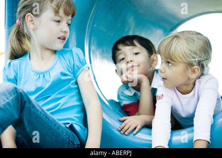 Children on playground equipment - Stock Photo