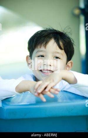Child on playground equipment - Stock Photo