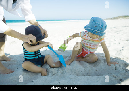 Children playing in sand - Stock Photo