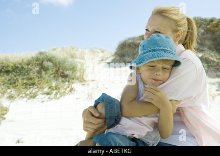 Little boy with mother on beach - Stock Photo
