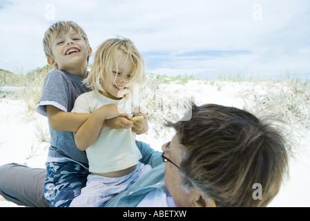 Family on beach - Stock Photo