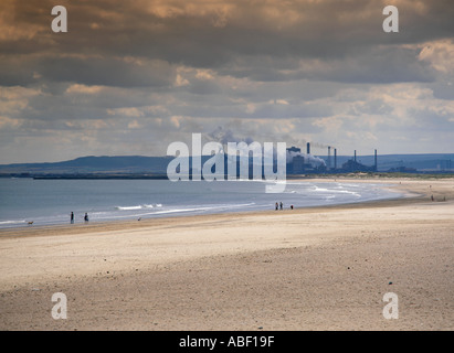 Redcar steelworks (centre), seen over the Tees Estuary from Seaton Carew sands, Teesside, Hartlepool, Cleveland, - Stock Photo