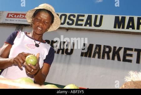 market vendor at roseau market dominica caribbean stock photo