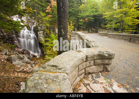 A waterfall along Hadlock Brook as seen from Waterfall Bridge on the carriage roads in Maine s Acadia National Park - Stock Photo