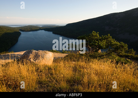 A grassy area on the summit of South Bubble Mountain in Maine s Acadia National Park Jordan Pond is below - Stock Photo