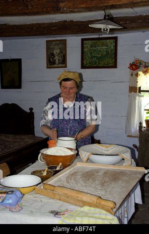 Woman preparing flat cake in Zagroda Guciow Poland - Stock Photo